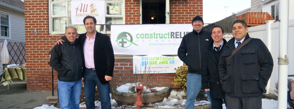Construct Relief founders stand in front of 125 Aviston Street - one of five homes we are rebuilding on Staten Island.